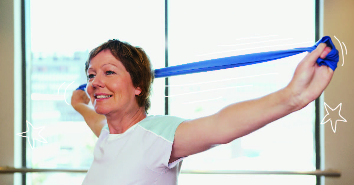 A woman with short hair stretches a blue resistance band behind her head.