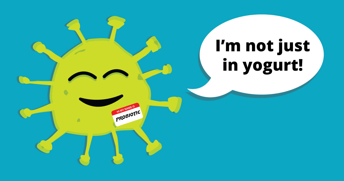 An animated green protein wearing a Probiotic name tag. Speech bubble reads: I'm not just in yogurt!